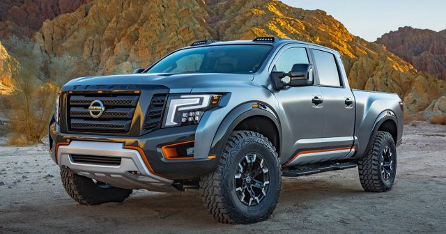 2019 Nissan Titan Nismo on white gmc pickkup